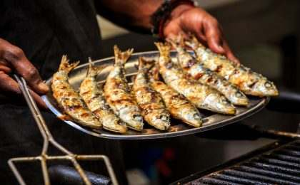 Freshly grilled sardines on silver plate, Portugal